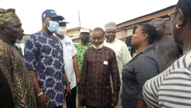 Photo of HID/Coker on Familiarization Visit to Abattoir: Frowns at environmental status, set to fumigate the entire market